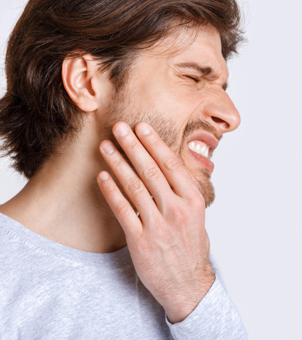Man with severe dental pain.