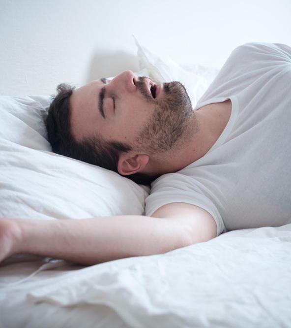 Snoring man sleeping on his back.