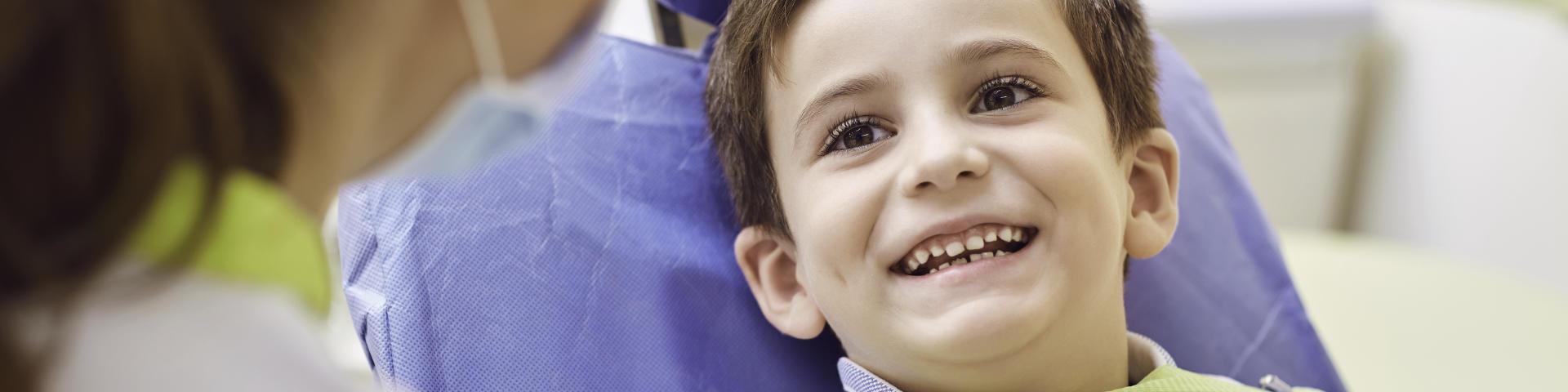 A joyful boy in a dental chair at Family Dentist in Rocky Hill, CT.