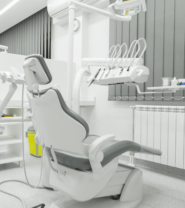 A dental chair and equipment in a treatment room at dentistry in West Hill, CT.