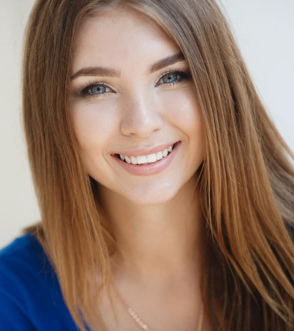 happy young woman with perfect smile